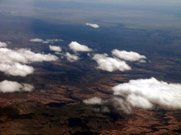 World Travel Photos :: Aerial views :: A view on desert through the clouds
